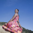 Mixed race woman in sundress in rural area — Stok fotoğraf