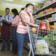 Stock Photo: Asimother and daughter grocery shopping
