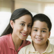 Hispanic mother hugging son — Stock Photo