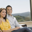 Hispanic couple hugging in living room — Stock Photo
