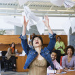 Multi-ethnic business throwing papers in air — Foto Stock