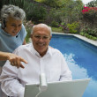 Senior couple looking at web camera on laptop — Stock Photo