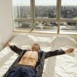 Hispanic man laying on bed — Stock Photo
