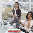 Businesswomen working together in office — Stock Photo