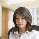 Eurasian businesswomen in office — Stock Photo #23331742