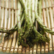 Close up of asparagus on bamboo — Foto Stock