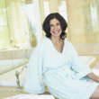 Smiling Middle Eastern woman in spa — Stock Photo
