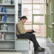Man reading book in library — Stock Photo