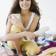 Middle Eastern woman holding magazine and coffee in bed — Stock Photo