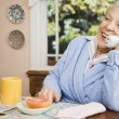 Senior woman talking on telephone — Stock Photo