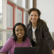 Businesswomen using laptop — Stock Photo