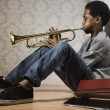 African boy playing trumpet — Stock Photo #23332058