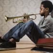 Stock Photo: Africboy playing trumpet