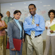 Multi-ethnic business posing in office — Stock Photo