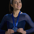 Gymnast with blue ribbon — Stock Photo