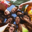 Multi-ethnic group of friends hugging — Stock Photo