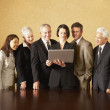 Group of businesspeople looking at laptop — Stock Photo