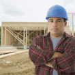Hispanic construction worker at construction site — Stock Photo