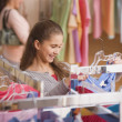 Hispanic girl shopping for clothing — Stock Photo