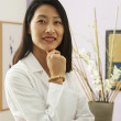 Asian female doctor in office — Stock Photo