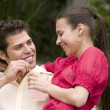 Hispanic couple smiling at each other — Stock Photo