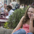 Mixed race girl talking on cell phone outdoors — Foto de Stock