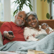 Senior African couple watching television — Stock Photo