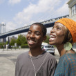 Stock Photo: Africbrother and sister sharing earbuds from mp3 player