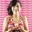 Native American woman holding birthday cupcake — Stock Photo