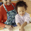 African grandmother and granddaughter making cookies — Stock Photo