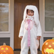 Young Chinese girl in rabbit costume with Halloween pumpkins — Stock Photo
