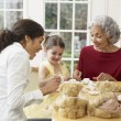Multi-generational Hispanic family having tea party — Stock Photo