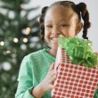 African American girl holding Christmas gift — Stock Photo