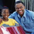 African father and son with go-cart — Stock Photo