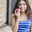 Middle Eastern woman holding apple — Stock Photo