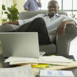 African businessman looking confident in office — Stock Photo