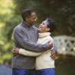 Stock Photo: Senior Africcouple hugging outdoors