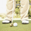 Close up of golfer putting on green — 图库照片