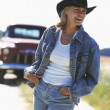 Woman wearing cowboy hat outdoors — Stock Photo