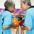 Two friends on bowling league about to bowl — Stock Photo