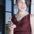 Glamorous Asian woman using cell phone — Stock Photo