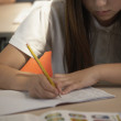Mixed Race girl doing school work — Stok fotoğraf