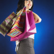 Glamorous Hispanic woman holding shopping bags — Stock Photo