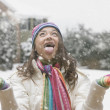 Mixed race girl with mouth open in snow — Stock Photo