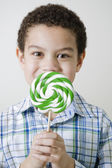Mixed race boy with oversized lollipop — Stock Photo