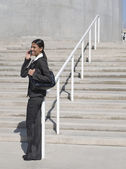 Indian businesswoman using cell phone outdoors — Foto Stock