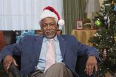 Bored African man in santa hat — Stock Photo
