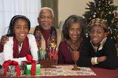 African couple with grandchildren celebrating Kwanzaa — Stock Photo