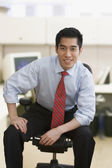Korean businessman smiling in office — Stock Photo