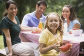 Hispanic family eating at picnic table — Stock Photo